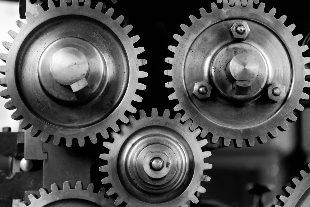 Three metal cogs connected