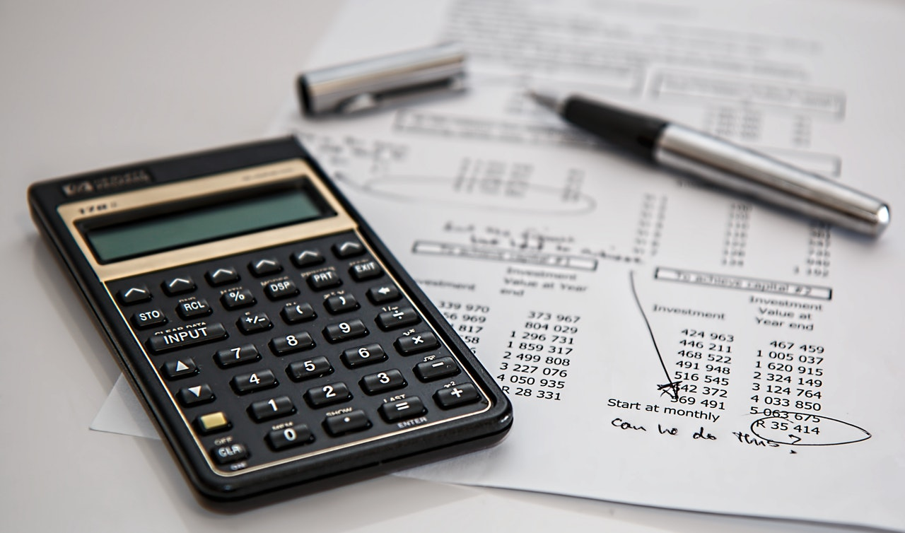 Calculator next to printed financial results