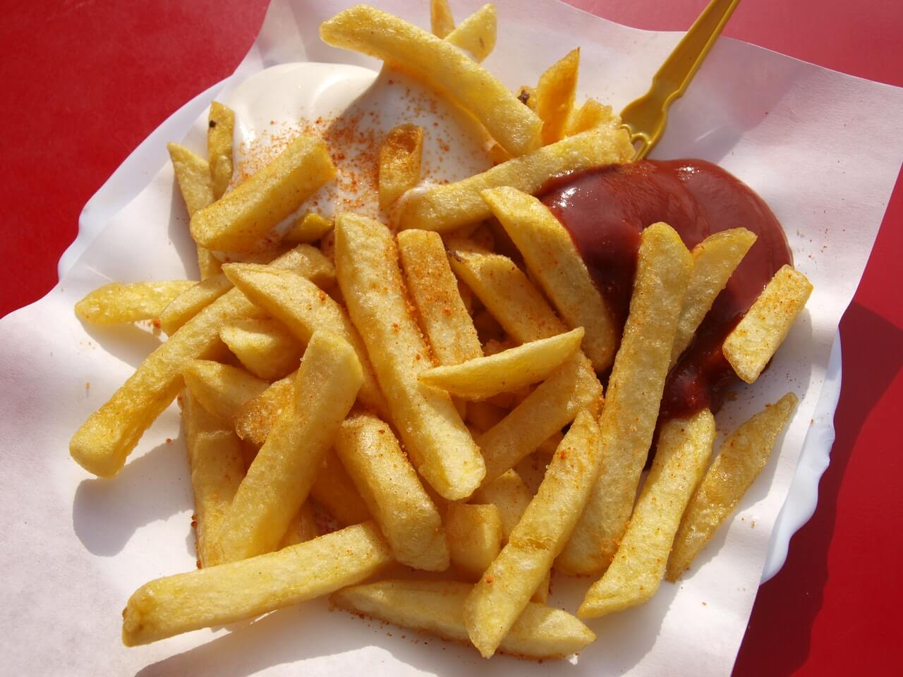 Fries with ketchup on the side