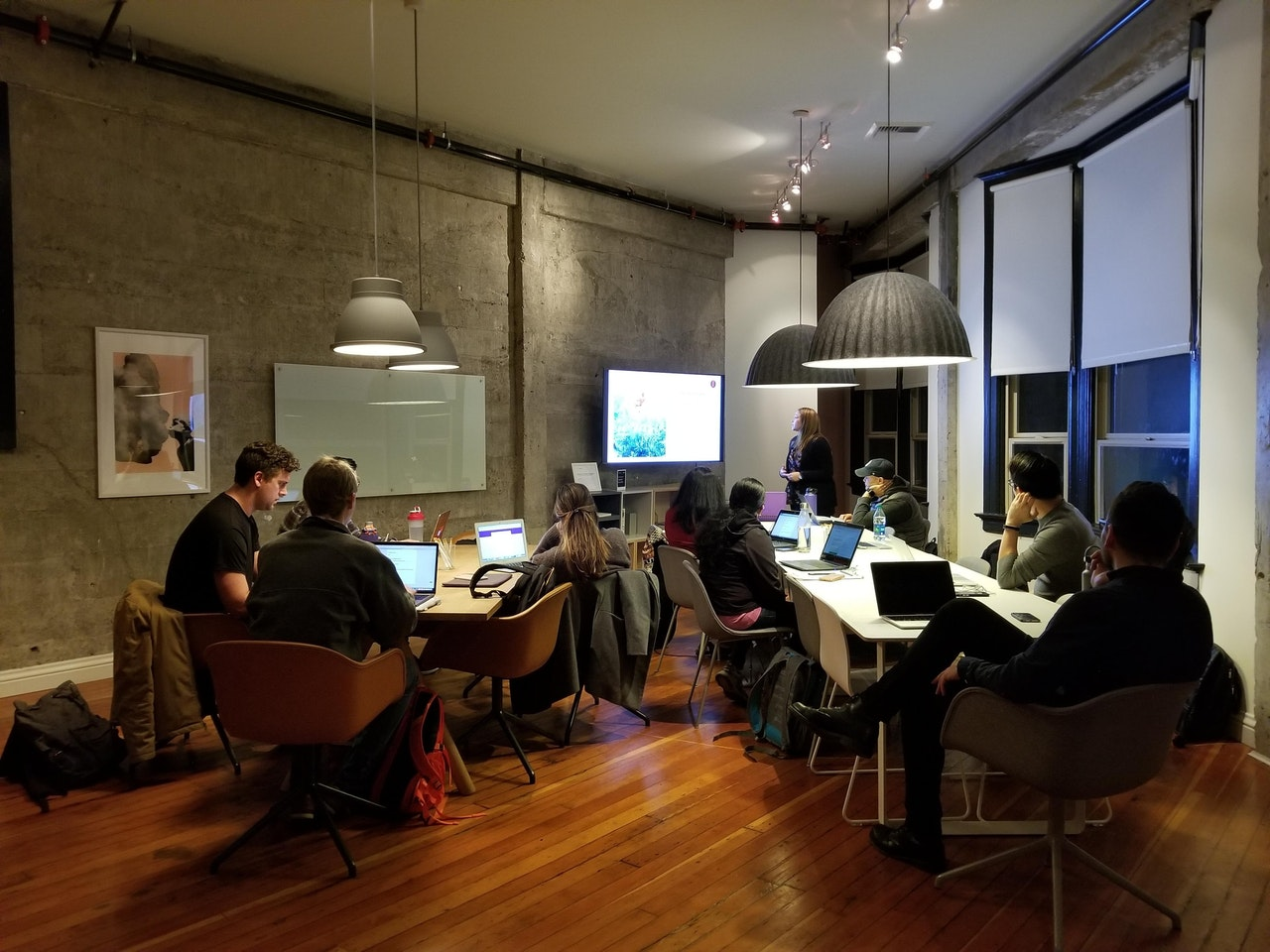 A modern office with people working around different desks