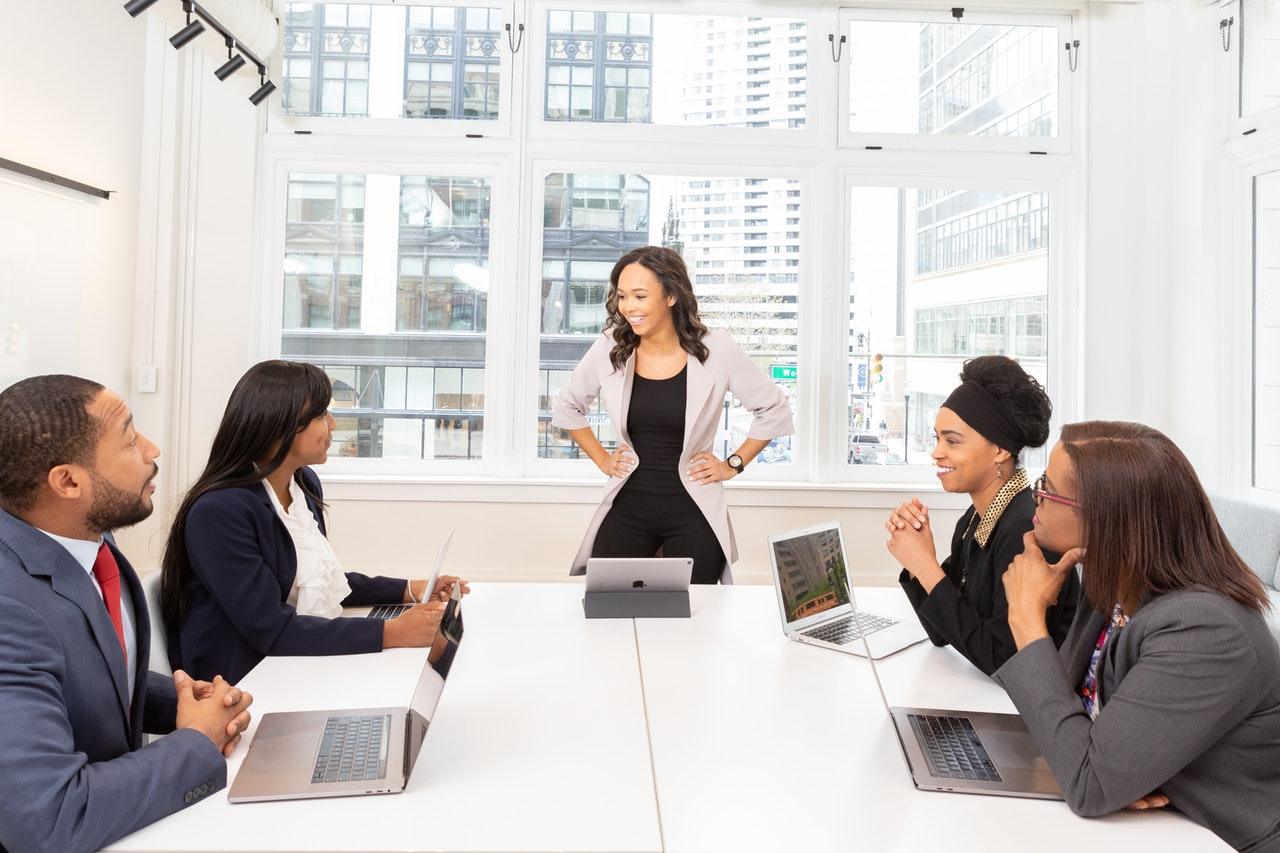 A management meeting with one person standing to present