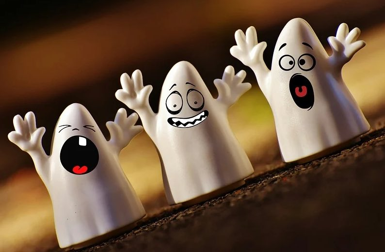 Three ghosts waving their arms