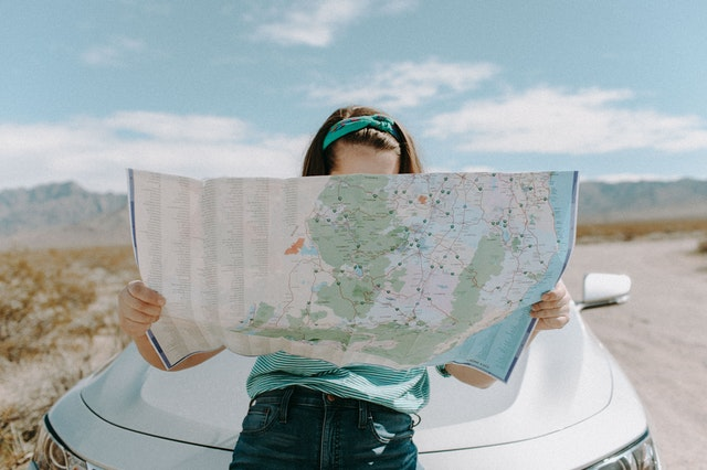 woman reading a map to represent different strategic directions a business could take