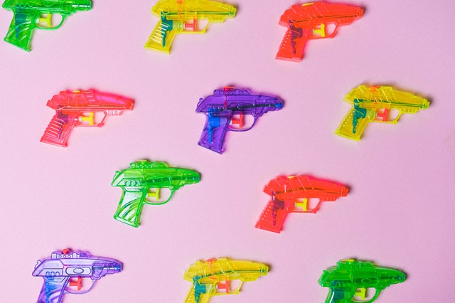 A series of water pistols in different colours representing different attack strategies