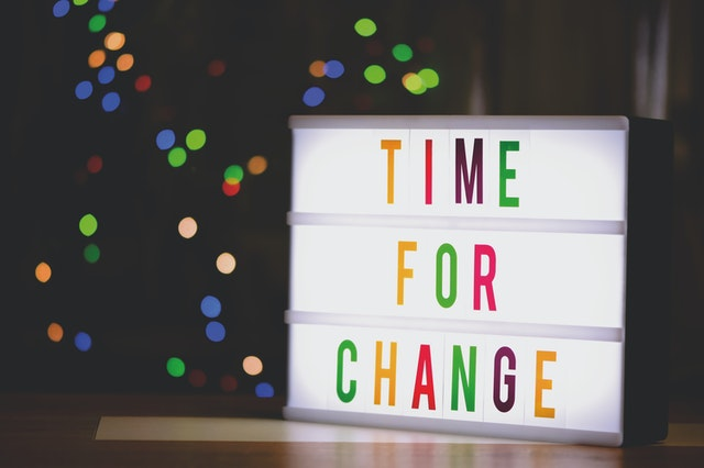 A sign saying Time for Change