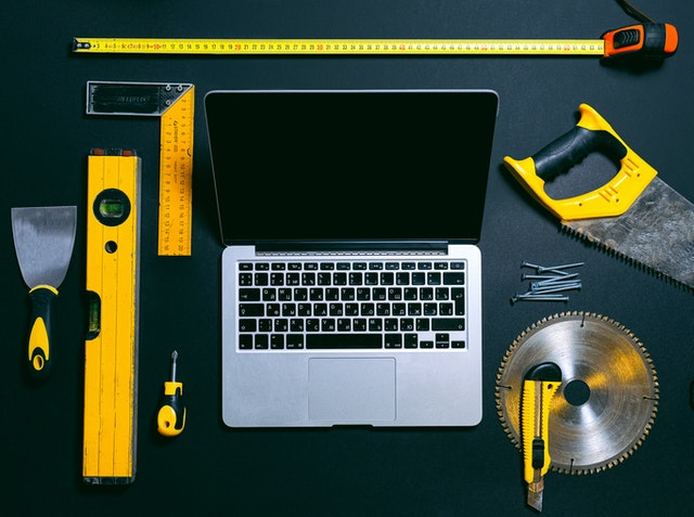 Laptop and tools to represent strategy tools to help build a turnaround strategy