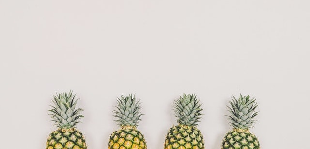 Four pineapples representing the 4Ps of Marketing