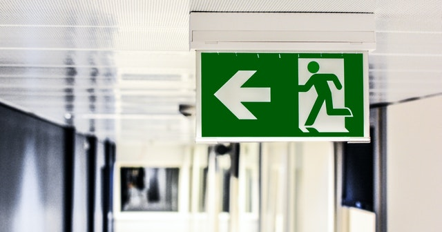 An exit sign to connote strategic withdrawal as a Defense Strategy in business