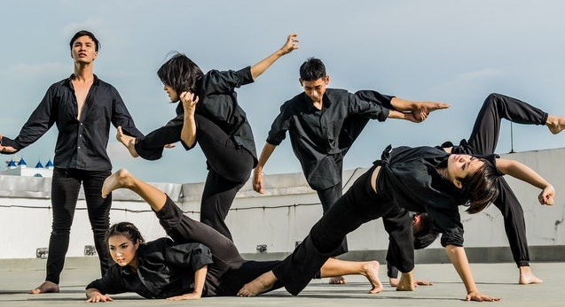 People in black adopting different martial art positions to represent a Mobile Defense Strategy in marketing